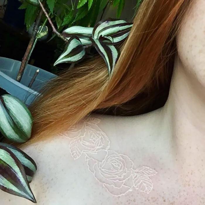 看起来像魔法符文的白色纹身设计插图(14)